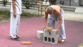 getlinkyoutube.com-Shaolin Kungfu Demonstration Breaking Iron and Bricks