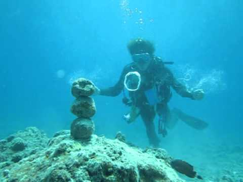 Scuba Diver Hadokens a Stack of Rocks