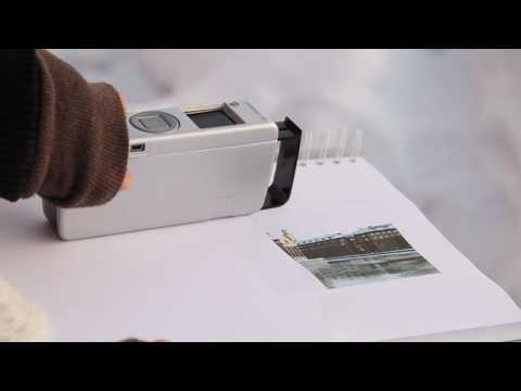 Handheld Digital Camera Transforms Into a Printer