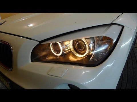 BMW X1 ремонт фары, устранение запотевания, чистка окислившихся контактов.