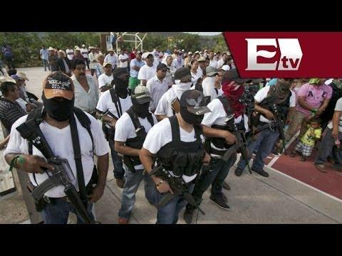 Desarme de autodefensas en Michoacán genera confusión / Opiniones encontradas