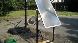 getlinkyoutube.com-Fresnel lens solar cooker using TV lens