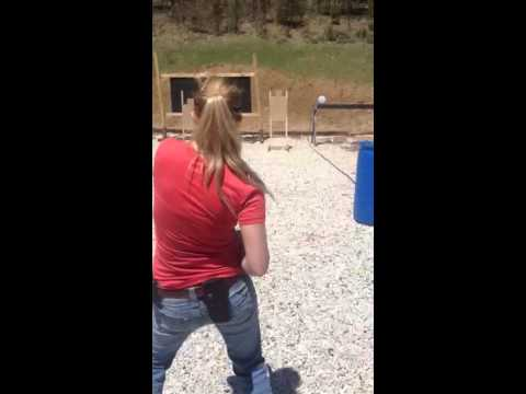 Ali Stricklin shooting a Ruger .45 long colt off the hip