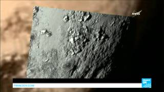 getlinkyoutube.com-Breathtaking pictures show deep canyons on Pluto's moon Charon - NEW HORIZONS