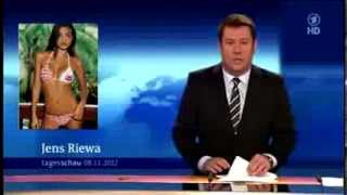 getlinkyoutube.com-Red faced newsreader caught looking at bikini pictures live on air