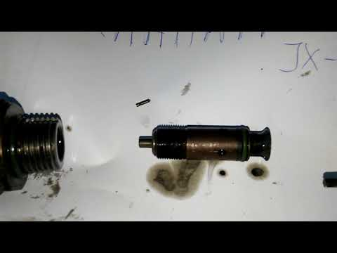 Клапан регулировки давления масла. двигатель jx-1.isuzu