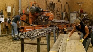 getlinkyoutube.com-Wood-Mizer Sawmill Re-Saws Recycled Barn Beams