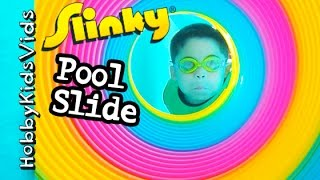 getlinkyoutube.com-GIANT Slinky SWIMMING! Pool Slide Waterfall Cut Scenes of Worlds Biggest Egg HobbyKidsVids