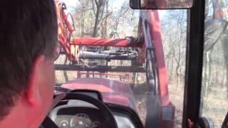 getlinkyoutube.com-Kioti NX6010 Pushing Back a Pile of Dirt