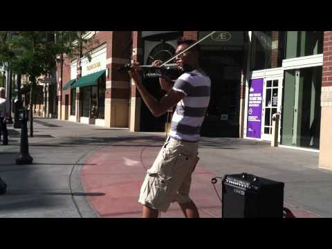 Busking electro-violinist visits Spokane