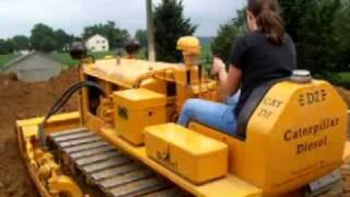 Caterpillar D2 1952 Daughter Andrea pushing dirt off the end
