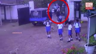 CCTV: Van driver purposely hits female security guard at school