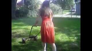 getlinkyoutube.com-windy orange dress 1 cutting the grass mowing the lawn wind blowing walking pushing mower woman mows