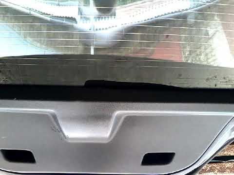 Где в Opel Мокко моторчик омывателя заднего стекла