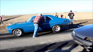 getlinkyoutube.com-Chevy Nova vs Nissan Skyline R32