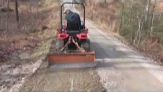 getlinkyoutube.com-Using a Subcompact Tractor to Smooth a Gravel Driveway - Part 2