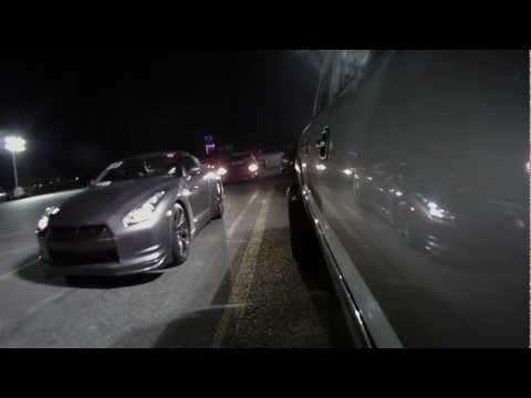 Racing Nissan GTR VS Duramax Diesel 1/4 mile drag race- start video @3.55 sec