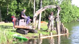 getlinkyoutube.com-Takeuchi TB015 Ramming Poels At A Lake