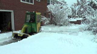 getlinkyoutube.com-John Deere 318 throwing snow