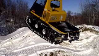 getlinkyoutube.com-Centaur with Argo 18 Argo Rubber Tracks with Ice Cleats playing on snow covered sand piles