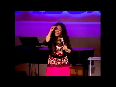 Dr. Cindy Trimm speaking at the Royal Beauty Women's Conference