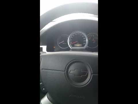 Расположение у Chevrolet Эванда моторчика омывателя лобового стекла
