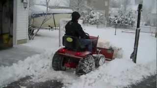 getlinkyoutube.com-Wheel Horse Plowing Snow Video
