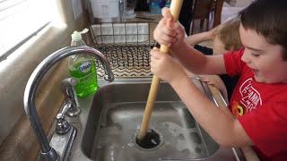 getlinkyoutube.com-Piranha Predicament. Aggressive Piranha Fish Toy Clogs the Drain!