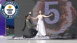 getlinkyoutube.com-Most costume change illusions in one minute - Guinness World Records