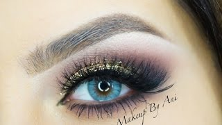 getlinkyoutube.com-Dramatic golden eyes with glitter by MakeupbyAni