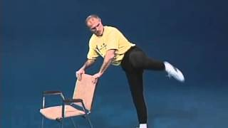 getlinkyoutube.com-Superfoot Wallace training for high kicks with a chair