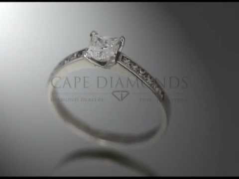 Princess cut,diamond,4 claws,6 side diamonds each side,platinum,engagement ring