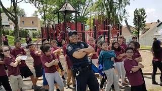 Police Officer Wiggle Dance with kids at the park