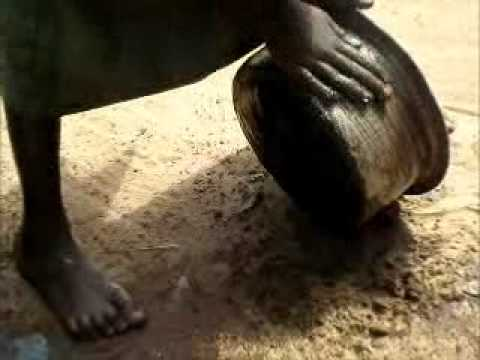 Cleaning Pots with Dirt in Sudan