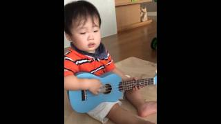 Baby Zoo with his first guitar from Uncle Marc Lian