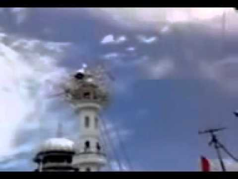 Miracle of Islam in Nepal Mosque minarets head flying up sky.