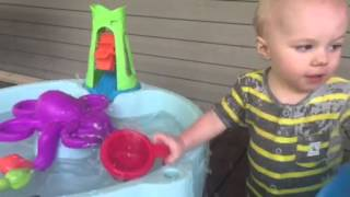Gunner loves his water table.