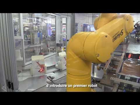Cellule robotisée pour la mise en boîte automatisée de bas de contention dans l'industrie médicale