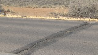 Residents in northwest Albuquerque fed up with deep cracks in the road