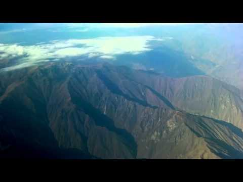 Flying over the Andes Mountains into the Amazon