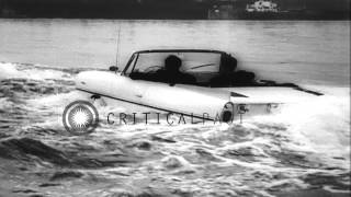 German drivers demonstrate Amphibious cars (aka Amphicar) on land and water in Ge...HD Stock Footage