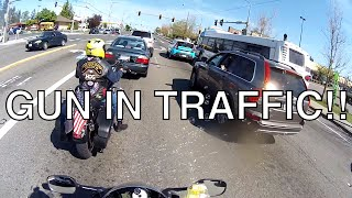 Biker Pulls Gun in Traffic!