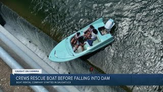 WATCH: Crews rescue boaters who nearly fall over dam