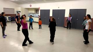 Delahey hip hop students make a circle dance
