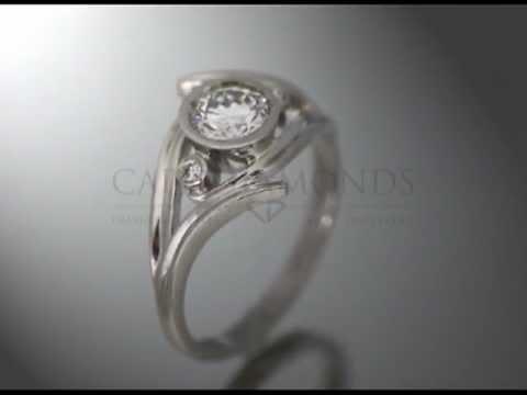 Split band ring,1 round diamond,2 smaller diamonds,platinum,band v-shape,engagement ring