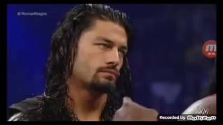 roman reigns spear to Mark Henry