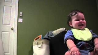 Baby laughs when ball bounce off his face