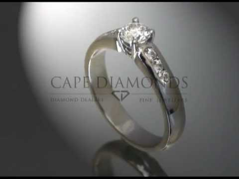 Simple side stone ring,round diamond,3 small diamonds on band,platinum,engagement ring.mp4