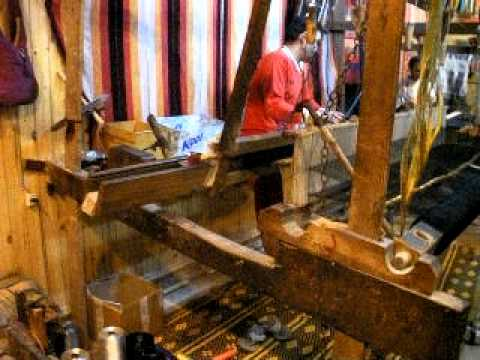 Men working the loom in Moroccan Scarf Shop