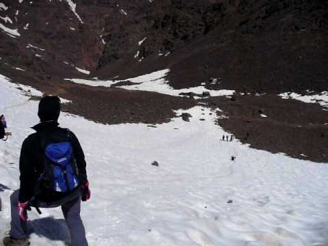Sliding down the snow on Mount Toubkal
